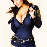 denise-milany-busty-cop-1.th.jpg